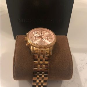 Authentic Michael Kors rose gold watch.